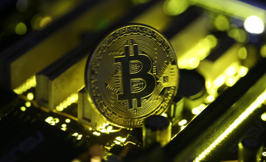 Bitcoin hits record high after smashing through $8,000 for first time
