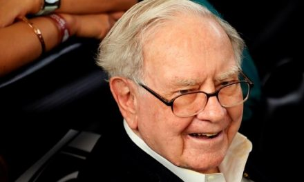 Apple hits record high after Buffett